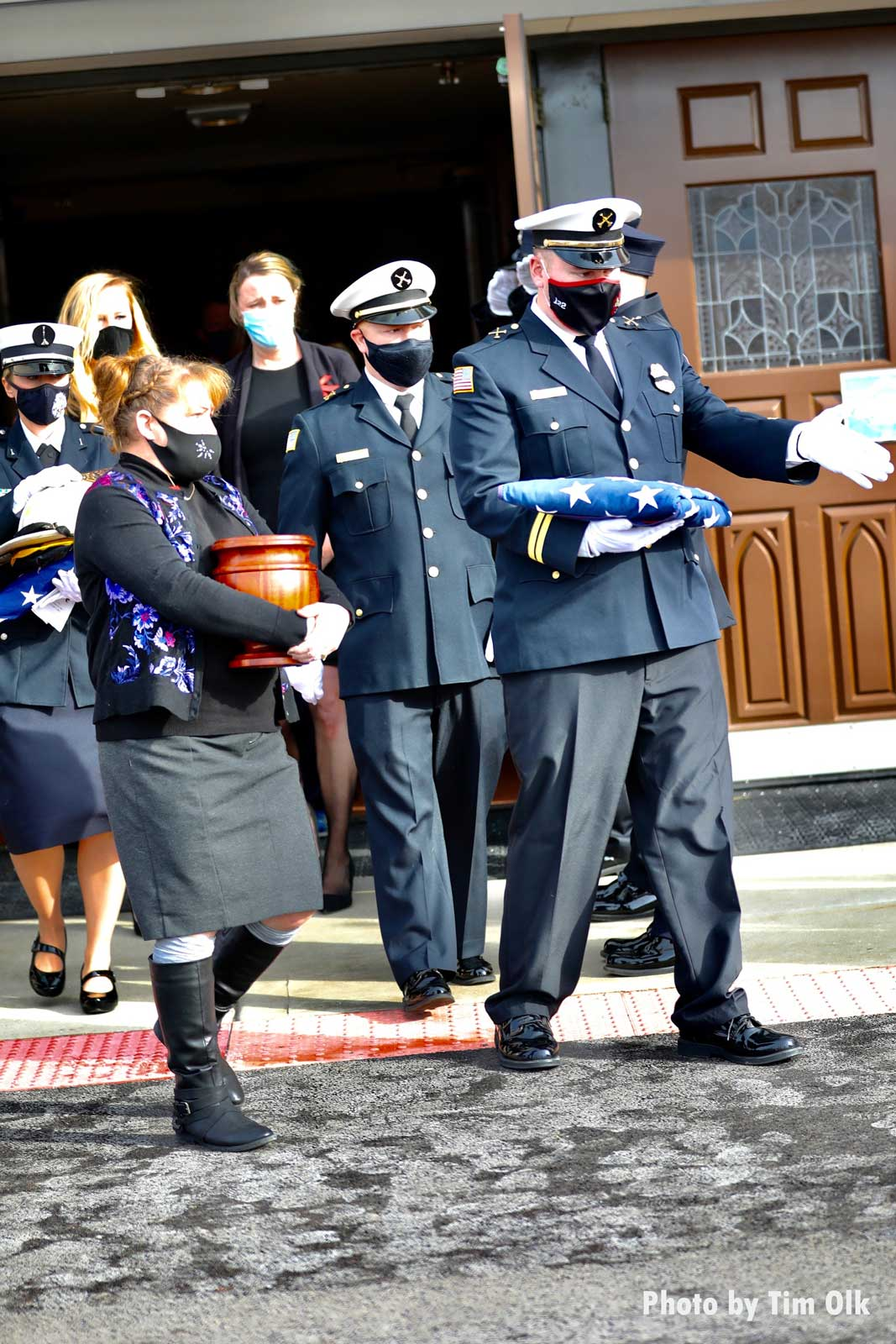 Urn and firefighter with folded flag at Al Schlick funeral