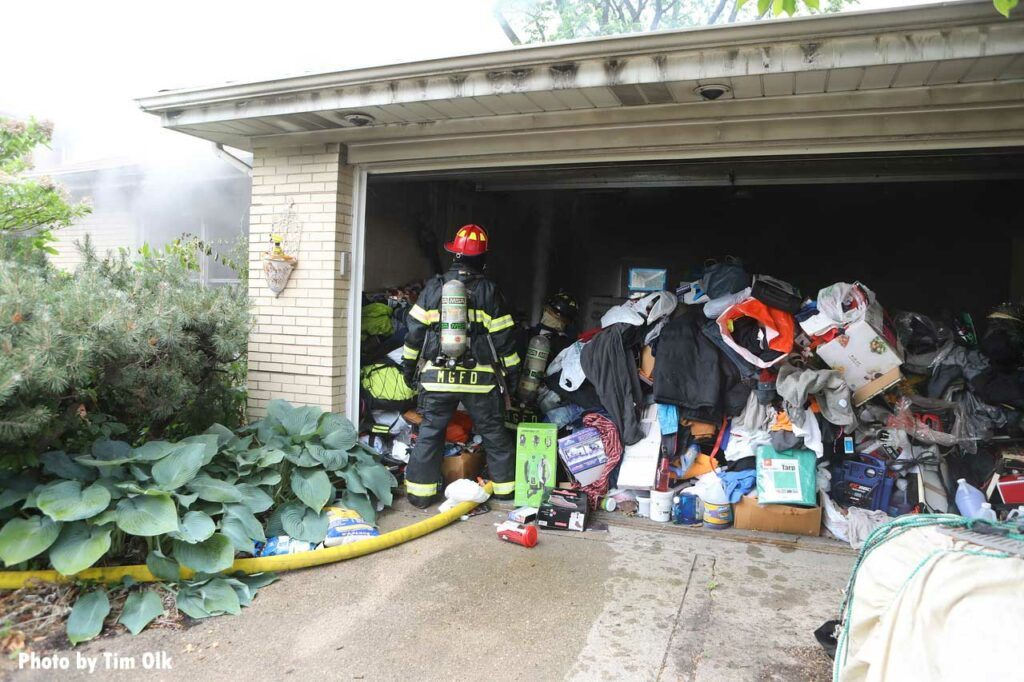 Firefighter enters a garage with hoarding conditions