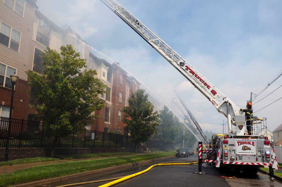 Firefighters battle a blaze at the 90 block of Beverly Street that is part of the Bristol Station Apartments in Carteret.