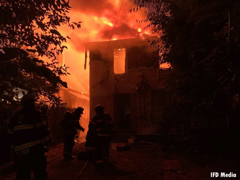 Home silhouetted by flames in Indianapolis