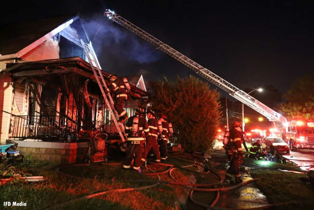 Multiple ladders thrown at the fire scene