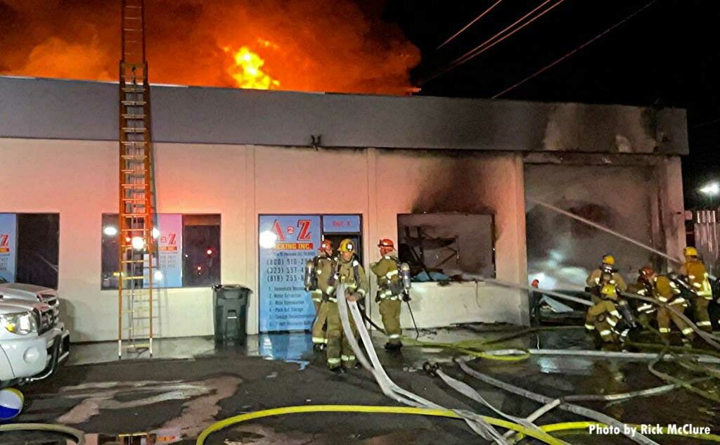 LAFD crews manage hoselines at structure fire