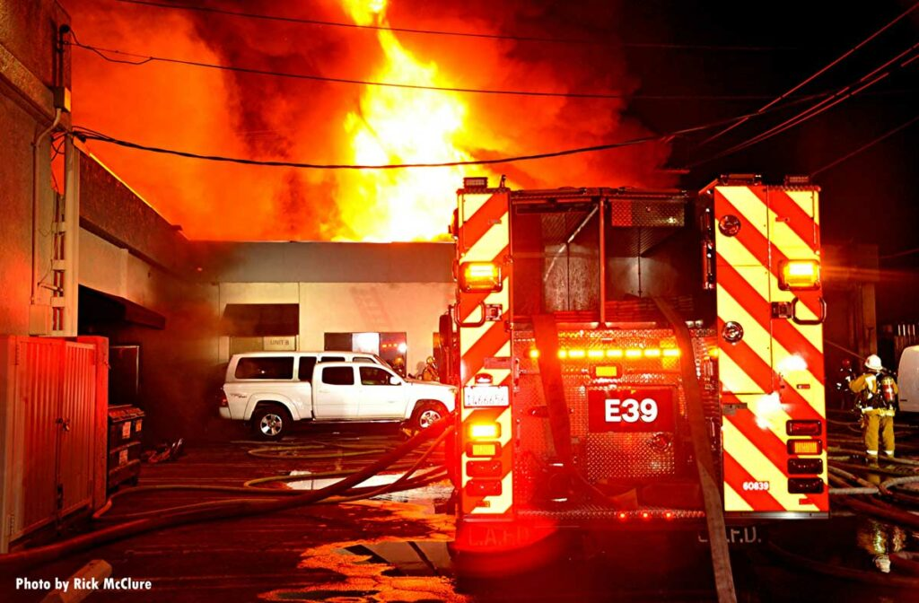 LAFD apparatus with fire emanating from building's roof