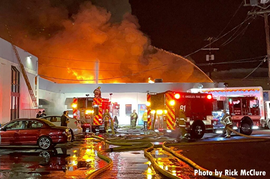 Structure fire with fire apparatus and firefighters in Los Angeles City