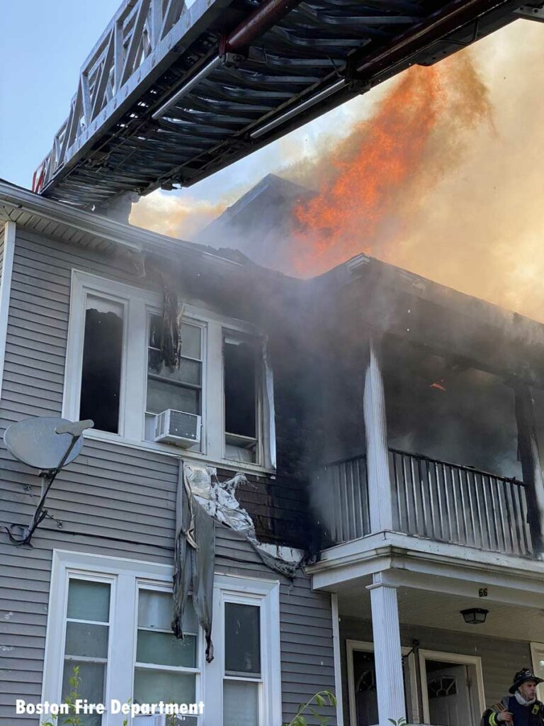 Flames shoot out of top of home in Dorchester area of Boston