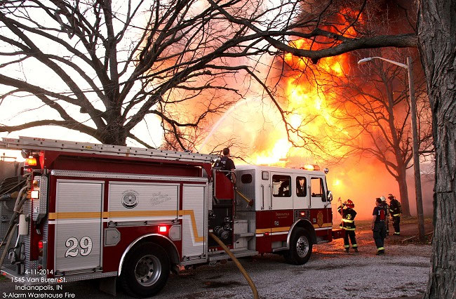 Indianapolis (IN) firefighters battled a three-alarm fire in a vacant warehouse yesterday.