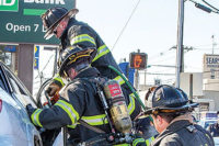 Firefighters extricating a patient